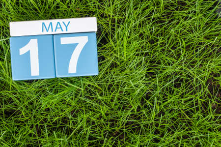 17th: May 17th. Day 17 of month, calendar on football green grass background. Spring time, empty space for text.