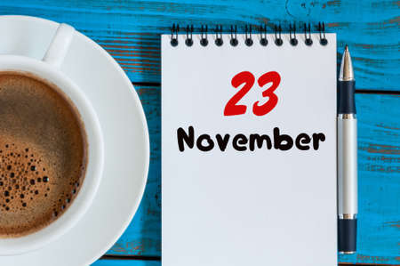 20 23 years: November 23rd. Day 23 of month, calendar and white coffee cup on workplace background.