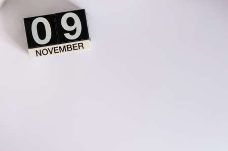 9th: November 9th. Day 9 of month, wooden color calendar on white background. Stock Photo