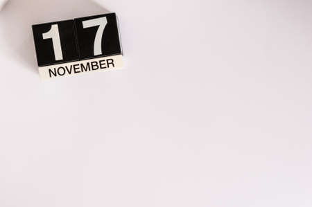17th: November 17th. Day 17 of month, wooden color calendar on white background.