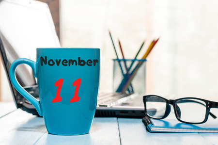 November 11th. Day 11 of month, calendar on morning hot drink cup at workplace background. Stock Photo