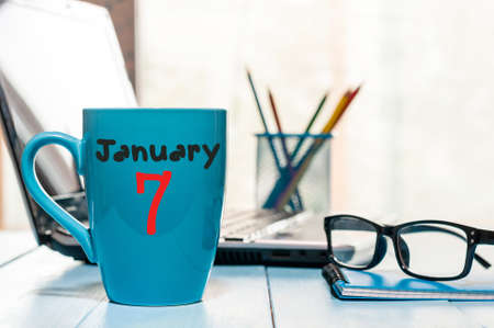 January 7th. Day 7 of month, Calendar on cup morning coffee or tea, workplace background. Stock Photo