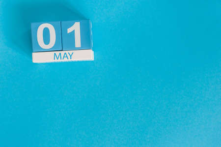 May 1st. Image of may 1 wooden color calendar on blue background.