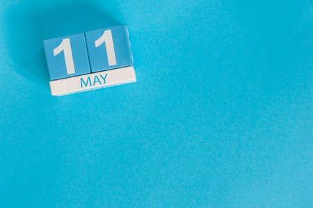 11th: May 11th. Image of may 11 wooden color calendar on blue background. Stock Photo