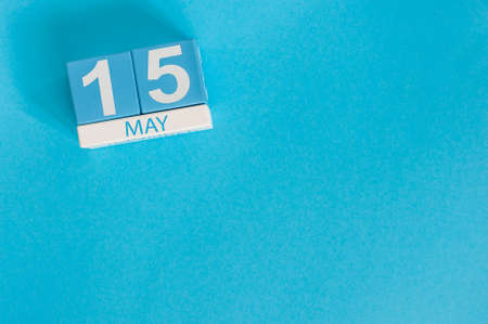 15th: May 15th. Image of may 15 wooden color calendar on blue background. Stock Photo
