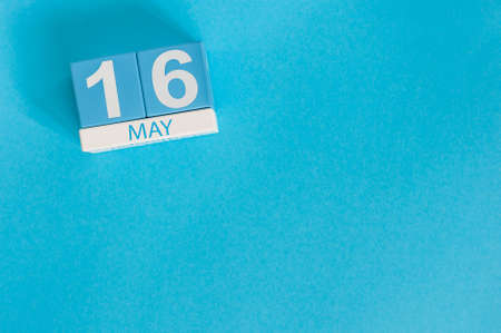 biographer: May 16th. Image of may 16 wooden color calendar on blue background. Stock Photo