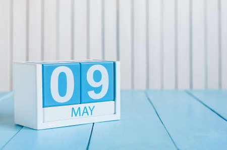 9th: May 9th. Image of may 9 wooden color calendar on white background.