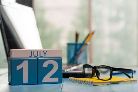 July 12th. Day 12 of month, wooden color calendar on office background. Stock Photo