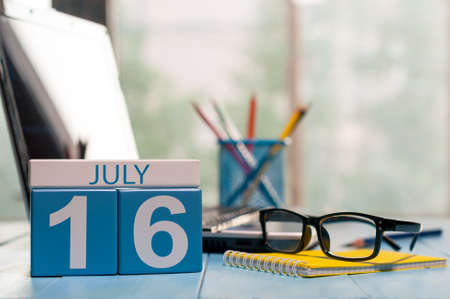July 16th. Day 16 of month, wooden color calendar on office workplace background. Stock Photo