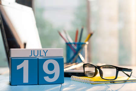 July 19th. Day 19 of month, wooden color calendar on office workplace background. Stock Photo