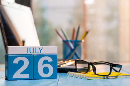 July 26th. Day 26 of month, wooden color calendar on workplace background. Stock Photo