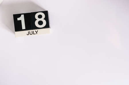 18 month old: July 18th. Image of july 18 wooden color calendar on white background. Stock Photo