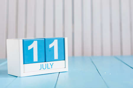 11th: July 11th. Image of july 11 wooden color calendar on white background.