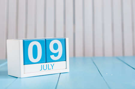 9th: July 9th. Image of july 9 wooden color calendar on white background. Stock Photo