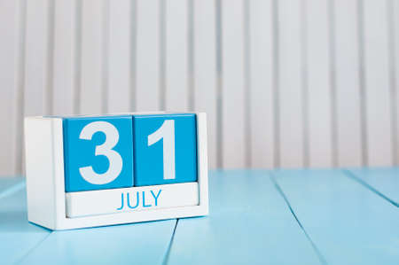 July 31st. Image of july 31 wooden color calendar on white background. Stock Photo