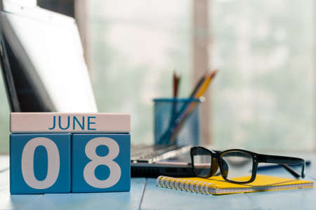 June 8th. Day 8 of month, wooden color calendar on workplace background. Stock Photo