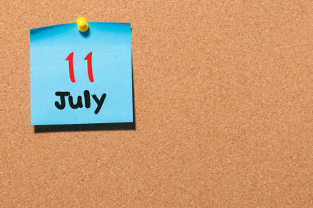 11th: July 11th. Day 11 of month, color sticker calendar on notice board. Stock Photo