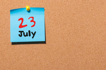 20 23 years: July 23rd. Day 23 of month, color sticker calendar on notice board.