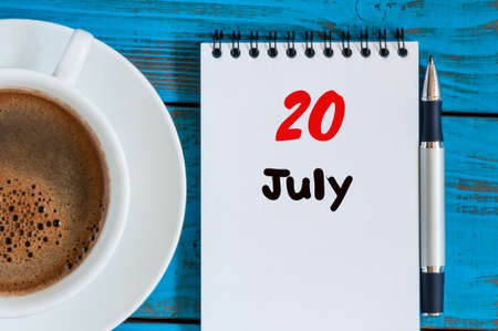 20th: July 20th. Day 20 of month, calendar on business workplace background with morning coffee cup. Summer concept. Empty space for text.