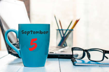 important date: September 5th. Day 5 of month, wooden color calendar on workplace background Stock Photo