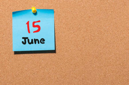 15th: June 15th. Day 15 of month, color sticker calendar on notice board.