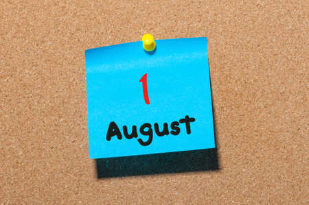 notice board: August 1st. Day 1 of month, color sticker calendar on notice board. Summer time. Close up. Stock Photo