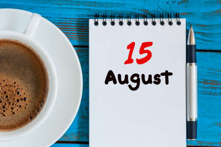 15th: August 15th. Day 15 of month, loose-leaf calendar on blue background with morning coffee cup.