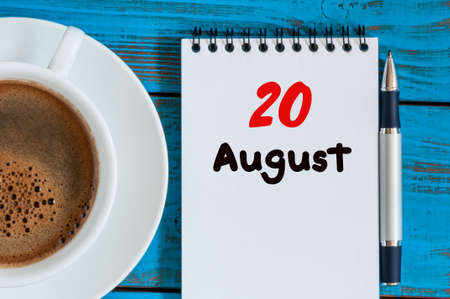 20th: August 20th. Day 20 of month, loose-leaf calendar on blue background with morning coffee cup.