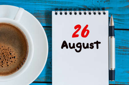 looseleaf: August 26th. Day 26 of month, loose-leaf calendar on blue background with morning coffee cup. Stock Photo