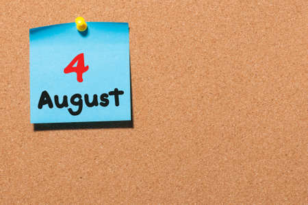 notice board: August 4th. Day 4 of month, color sticker calendar on notice board. Stock Photo