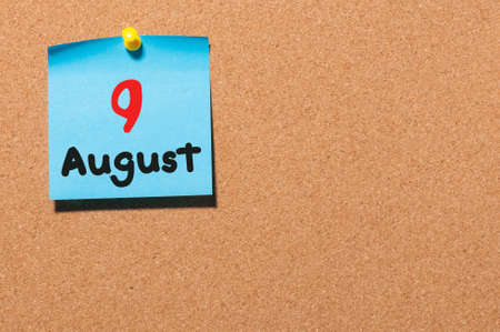 9th: August 9th. Day 9 of month, color sticker calendar on notice board.
