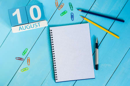 10th: August 10th. Image of august 10 wooden color calendar on blue background.