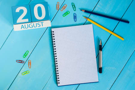 20th: August 20th. Image of august 20 wooden color calendar on blue background. Stock Photo