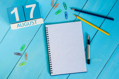 17th: August 17th. Image of august 17 wooden color calendar on blue background.