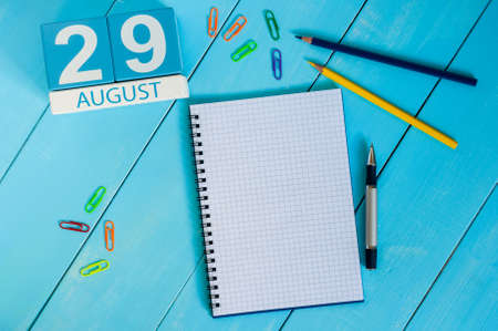 next day: August 29th. Image of august 29 wooden color calendar on blue background.