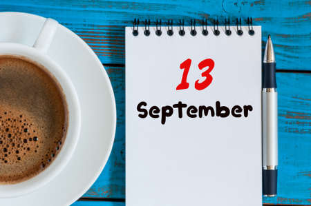 13th: September 13th. Day 13 of month, loose-leaf calendar and coffee cup at lawyer workplace background. Autumn time. Empty space for text.