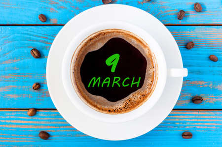 9th: March 9th. Day 9 of month, calendar written on morning coffee cup at blue wooden background. Stock Photo