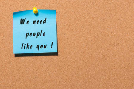 in need of space: We Need People Like You - text on sticker pinned at notice board with empty space. Business concept.