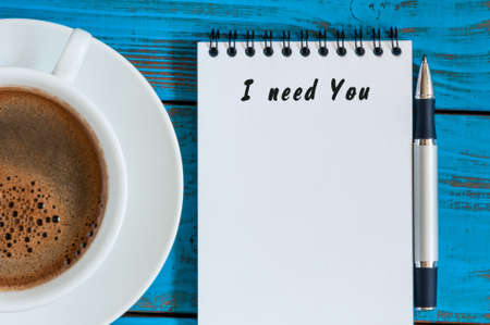 in need of space: I need you written in notepad near morning cup of coffee. With empty space for text.