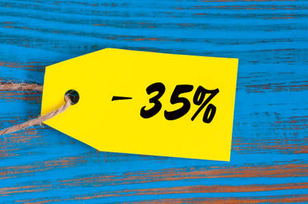 thirty five: sale minus 35 percent. Big sales thirty five percents on blue wooden background for flyer, poster, shopping, sign, discount, marketing, selling, banner, web