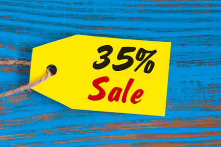 sale minus 35 percent. Big sales thirty five percents on blue wooden background for flyer, poster, shopping, sign, discount, marketing, selling, banner, web