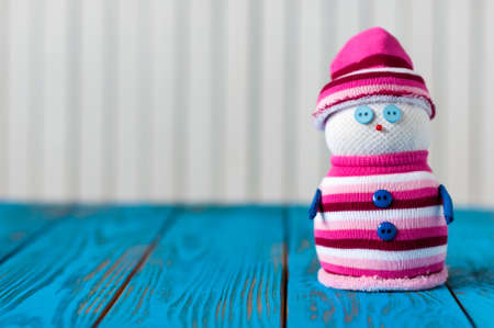 snowman on blue wooden background. With empty space for postcard text.