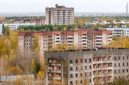 exclusion: Pripyat city exclusion zone from the high empty abandoned building. Autumn time. Chernobyl, Ukraine. Stock Photo