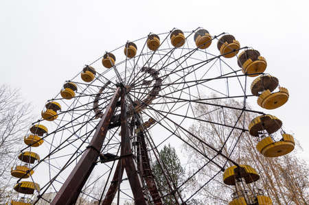Abandoned wheel of view in pripyat city ghost - town in exclusion radioactiv zone Chernobyl Ukraine. Nuclear dirty place.