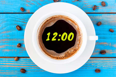12 o clock: Its twelve oclock already. Time to wake up and hurry. An image of a top viewed coffee cup with clock face showing 12:00 am or pm.