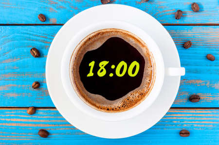 pm: Its eighteen oclock already. Time to finish work and go home or have supper. An image of a top viewed coffee cup with clocks face showing 18:00 pm.
