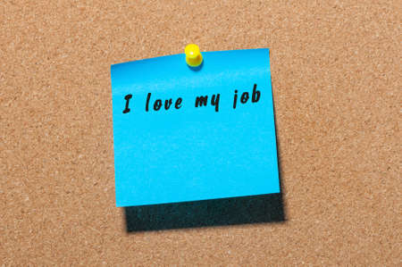 I love my job - words on blue sticker pinned at cork notice board. Stock Photo