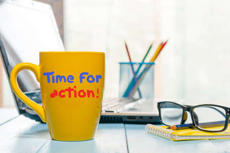 activism: TIME FOR ACTION text on morning coffee or tea mug, business concept, motivate inscription