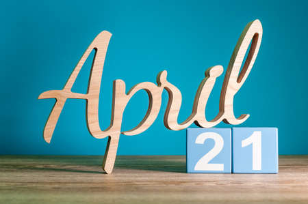 April 21st. Day 21 of month, daily calendar on desk with blue background. Spring time concept