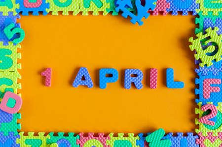 Fools Day, calendar date April 1. Toy puzzle frame and letters